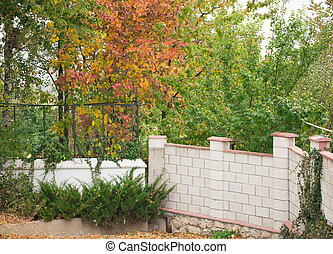 Stone wall around garden