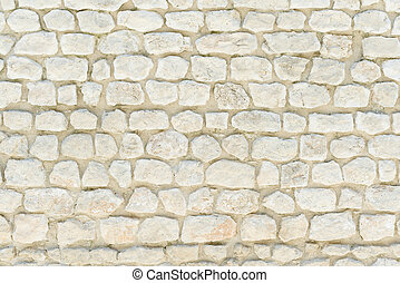 Stone wall background, pattern, texture, wallpaper. Traditional construction in Provence, Cote Azur, France, Europe.
