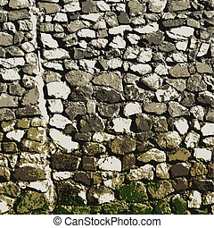 Stone wall - Stones form a wall. Abstract background.