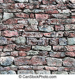 Stone wall closeup, stonewall pattern background, old aged weathered red and grey grunge limestone dolomite calcium carbonate hard sedimentary slate slab rock texture, natural grungy textured bricks, beige, yellow, reddish, gray brick vintage