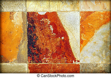 Detail abstract of old aged stone wall with brown, tan, orange, and white