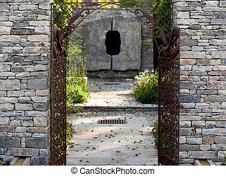 Stone wall entrance to a garden