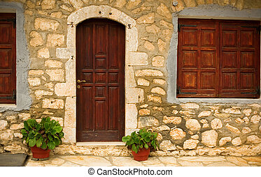 Stone wall of a rural house in a famous Greek mountain ...