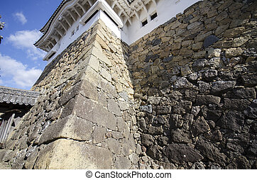 Stone wall of ancient castle in Himeji