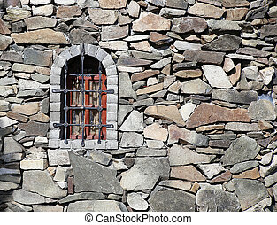 stone wall of fortress with window