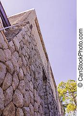 Stone wall of villa