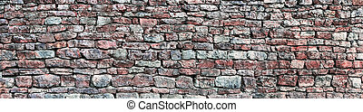 Stone wall panorama, panoramic stonewall pattern background, old aged weathered red and grey grunge limestone dolomite calcium carbonate hard sedimentary slate slab rock texture, natural grungy textured bricks, beige, yellow, reddish, gray brick vintage closeup