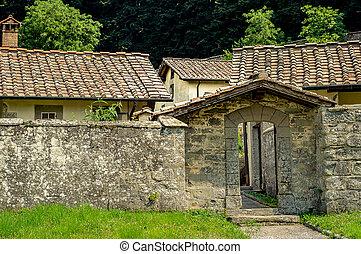Stone wall settlement. Entrance gate