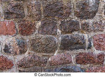 stone wall weathered baked texture uneven cobblestone piece of old construction background urban