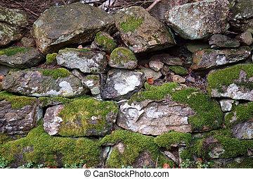 stone wall weathered moss