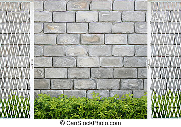 stone wall with green leaves