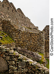 Stone walls of an Inca castle in the mountains.