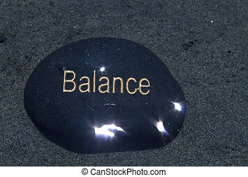 stone with balance written on it.