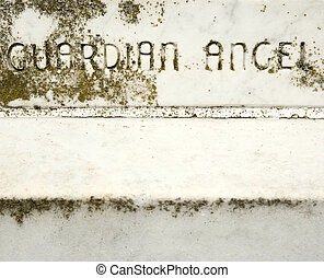 Stone with 'Guardian Angel'.