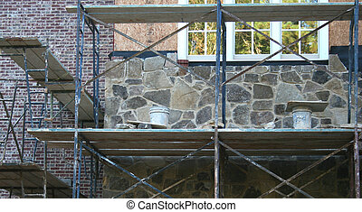 Stone Work - Stone work being added on to new house under...