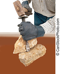 Stone-work - stoneworker with hammer chisels stone