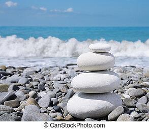 Stone zen-like balance - balance white stones zen-like on a...