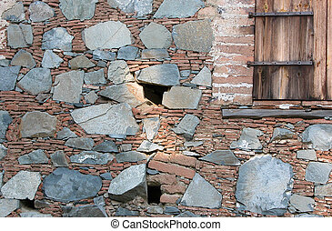 Stoned wall with a wooden window