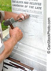 Stonemason Engraving Gravestone - Stonemason using...