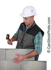 Stonemason holding a mallet