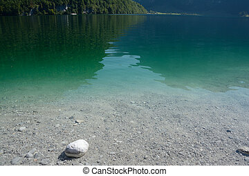 Stones and clear water in Koenigssee lake