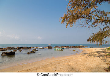 stones and fishing boats on the beach of Phu Quoc, Vietnam