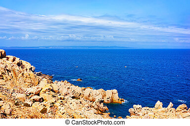 Stones and rocks on Mediterranean sea in Capo Testa reflex...