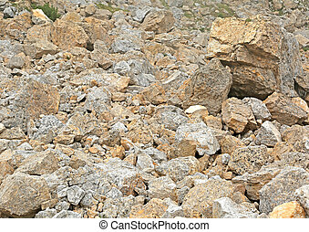 stones and solid rock of a landslip