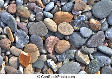 Background photo. Colorful stones on a beach.