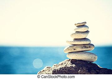 Stones balance, vintage pebbles stack background - Stones...
