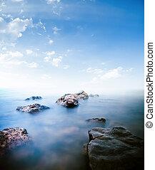 Stones calm sea. Long exposure shot