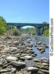 Stones in a river and bridge