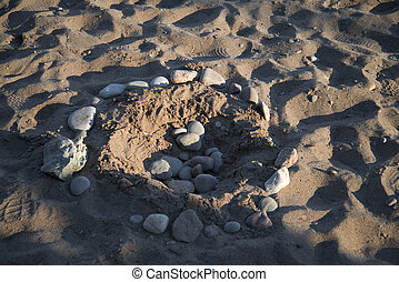 Stones in Circle on Sandy Beach - Circular Formation of...