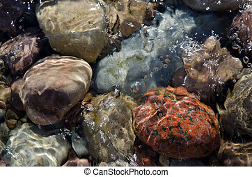 Stones in clear water