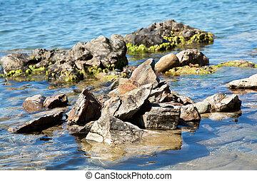 Stones in deep blue sea