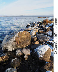 stones in the ice on the lake