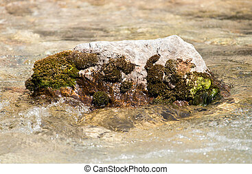 Stones in the water in a river