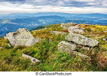 stones in valley on the edge of mountain range
