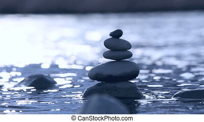 Stones in water in slow motion - Stones in water stacked as...