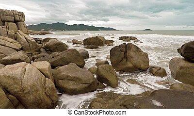 Huge stones on an ocean coast on a cloudy day at Hon Chong rocks. Nha Trang, Vietnam