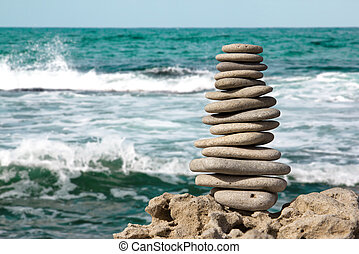 Stones on sea - Staked stones on sea background macro...