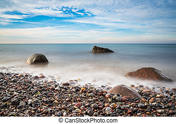 Stones on shore of the Baltic Sea in Elmenhorst, Germany.
