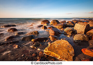 Stones on shore of the Baltic Sea in Heiligendamm, Germany.