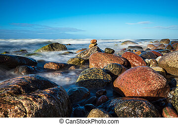Stones on shore of the Baltic Sea near Warnemuende, Germany.