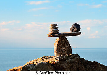 Stones on the boulder - Symbol of scales is made of stones...