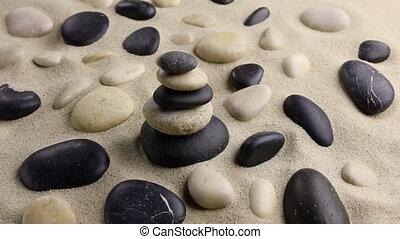 Stones pyramid on sand standing among the rocks, harmony,...