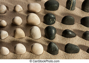 Stones sticking out of the sand in the sunlight