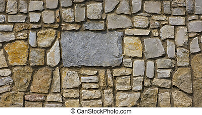 Stonewall - An old stone wall made from unevenly sized...
