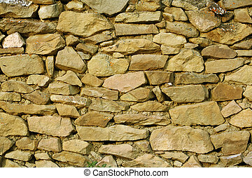 Stonework - a fragment of a stone wall in the Caucasian...