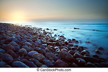 Stony beach - Stony calm Baltic beach seascape after sunset